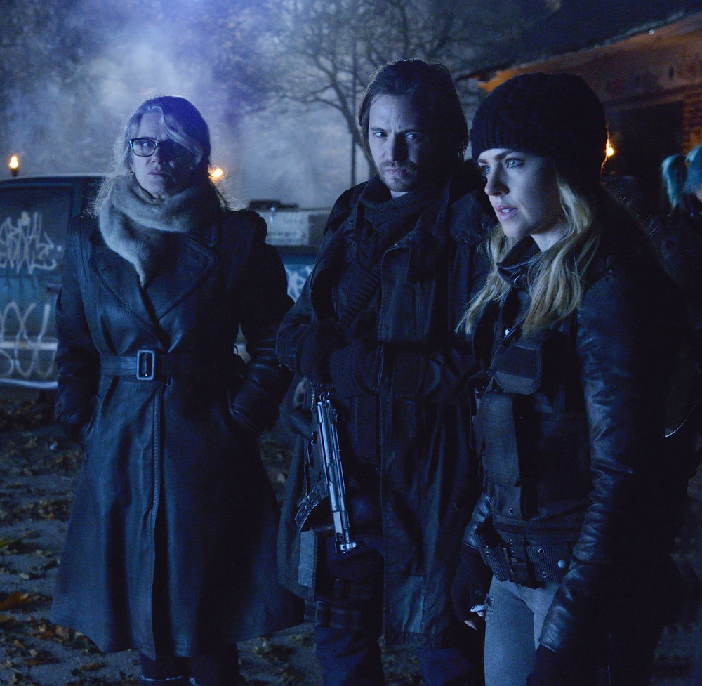 "12 MONKEYS -- ""Memory of Tomorrow"" Episode 213 -- Pictured: (l-r) Barbara Sukowa as Katarina Jones, Aaron Stanford as James Cole, Amanda Schull as Cassandra Railly -- (Photo by: Ben Mark Holzberg/Syfy)"